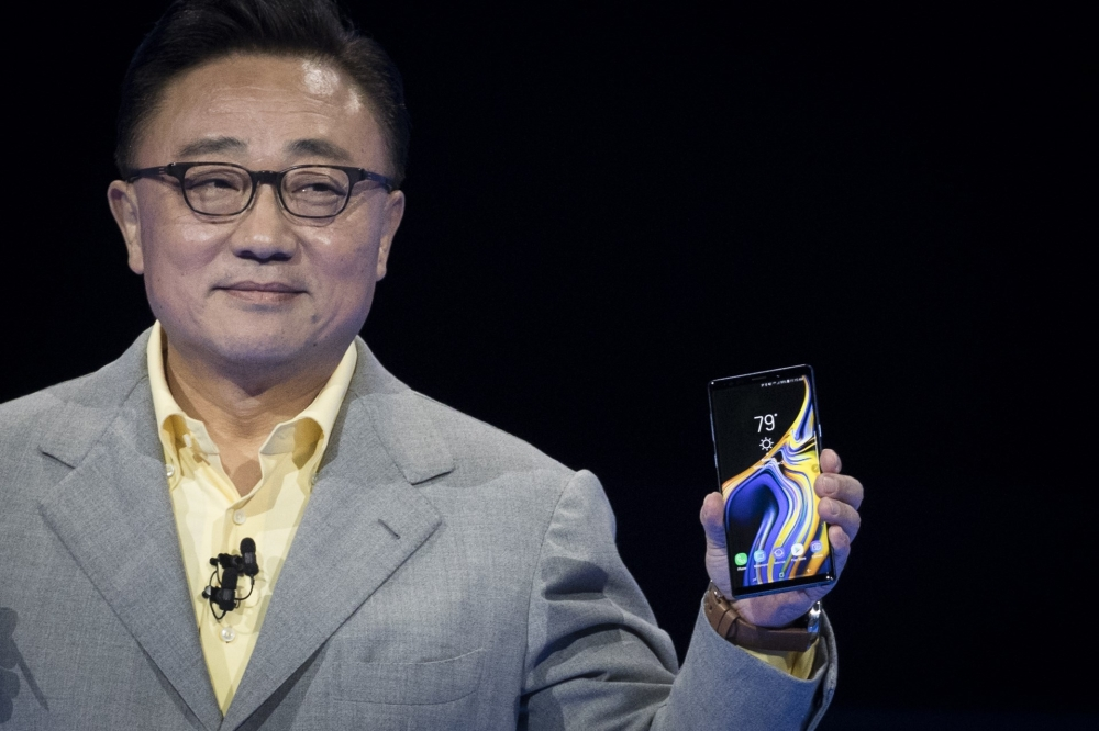 DJ Koh, president and CEO of Samsung Electronics, introduces the new Samsung Galaxy Note 9 smartphone at the Barclays Center, on Thursday in the Brooklyn borough of New York City. The new smartphone will go on sale on Aug. 24. — AFP