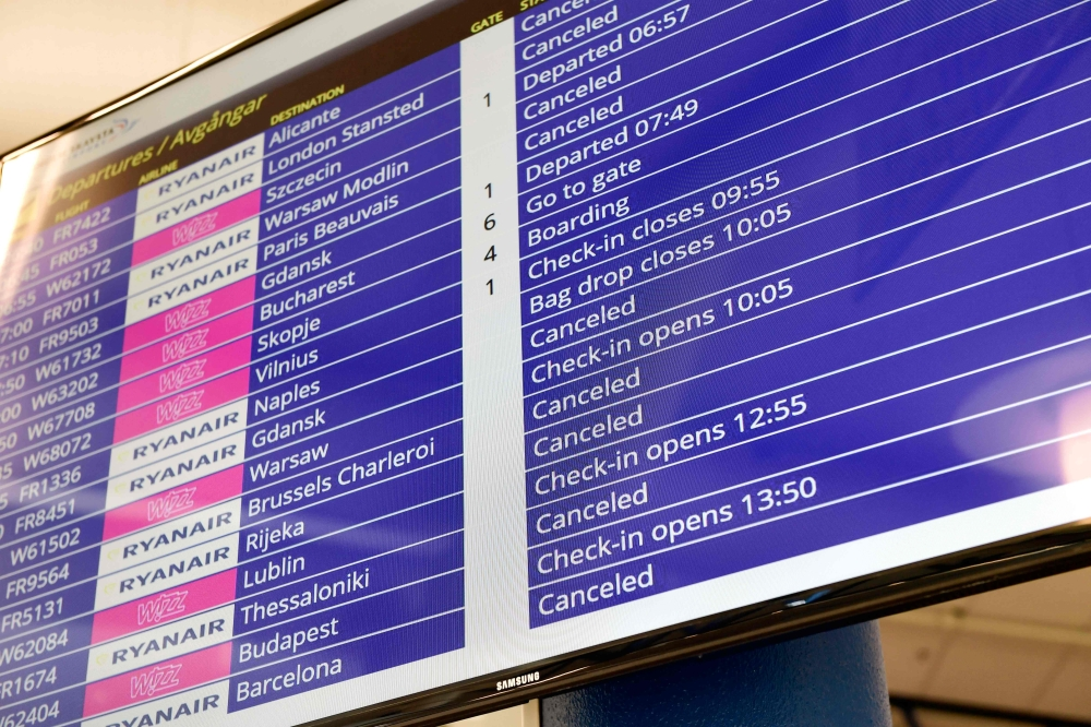 Canceled Ryanair flights are seen on the announcement board at the terminal of the Skavsta Airport in Nykoeping, Sweden on Friday. Ryanair pilots are staging a 24-hour walk-out involving staff in Germany, Sweden, Ireland, Belgium and the Netherlands. About 50,000 passengers are understood to have been told of cancellations on 400 flights due to the strike action. — AFP