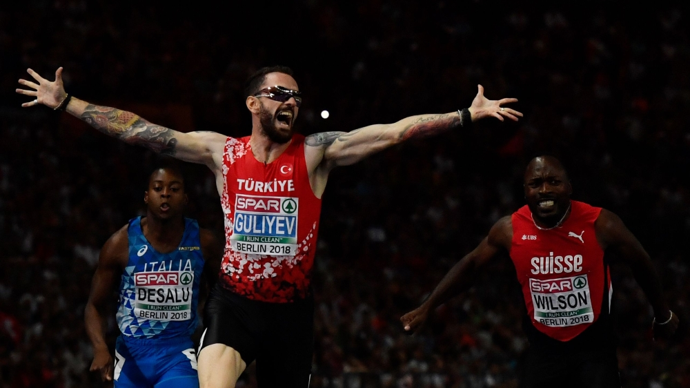 Turkey's Ramil Guliyev celebrates winning the men's 200m final race during the European Athletics Championships at the Olympic stadium in Berlin on Thursday. — AFP