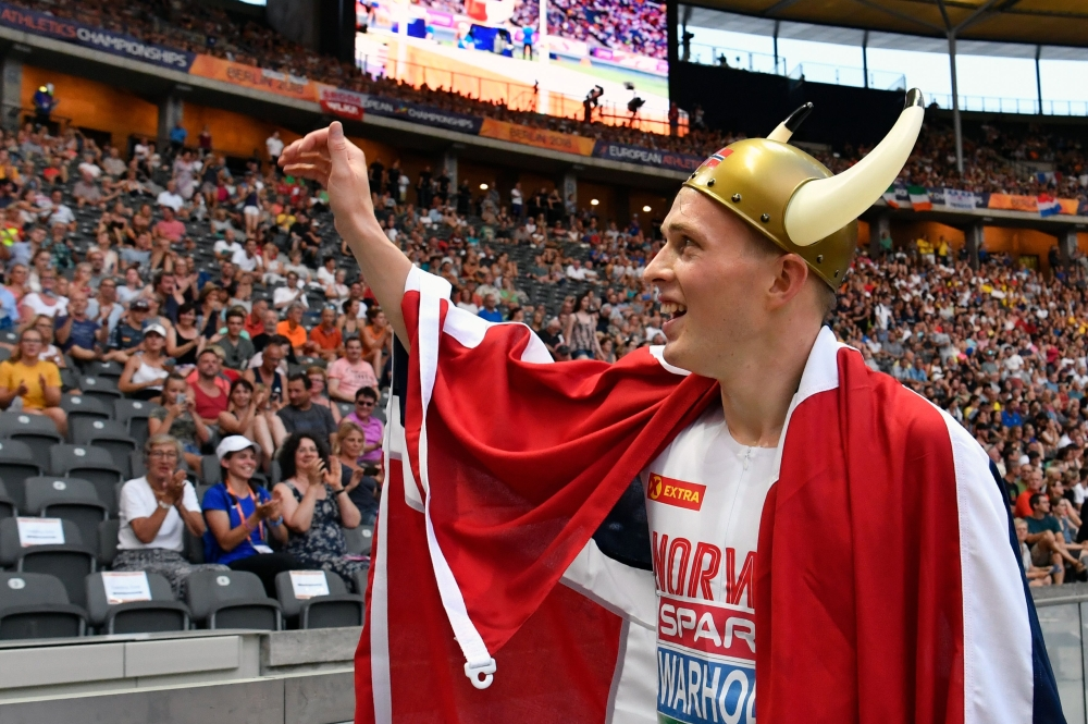 Norway's Karsten Warholm celebrates after winning the men's 400m Hurdles final race during the European Athletics Championships at the Olympic stadium in Berlin on Thursday. — AFP
