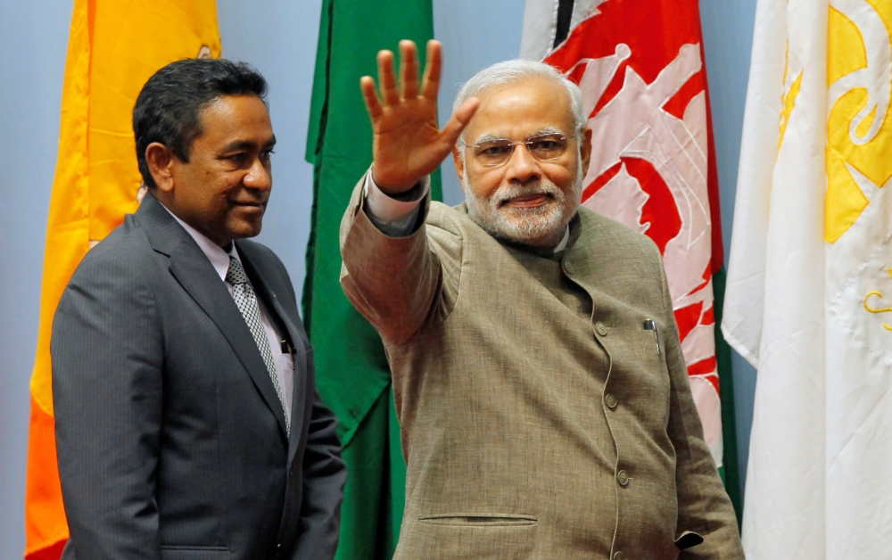 FILE PHOTO: Indian Prime Minister Narendra Modi, right, waves as Maldives President Abdulla Yameen looks on during the closing session of 18th South Asian Association for Regional Cooperation (SAARC) summit in Kathmandu, Nepal, in this Nov. 27, 2014 file photo. — Reuters