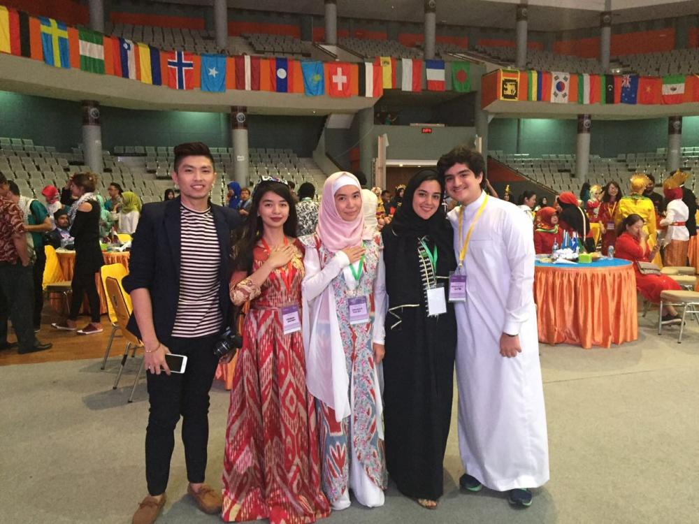 Hadeel in black with her brother in white when joining the UM iCamp program in Malang.