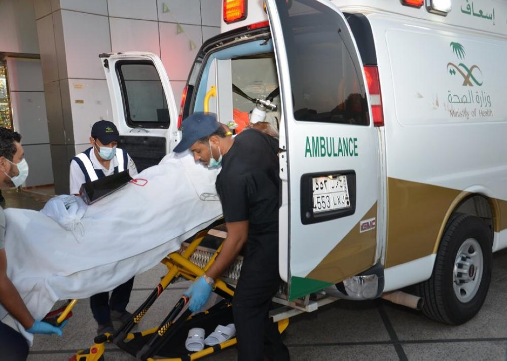 Paramedics shifting sick pilgrims to Arafat.