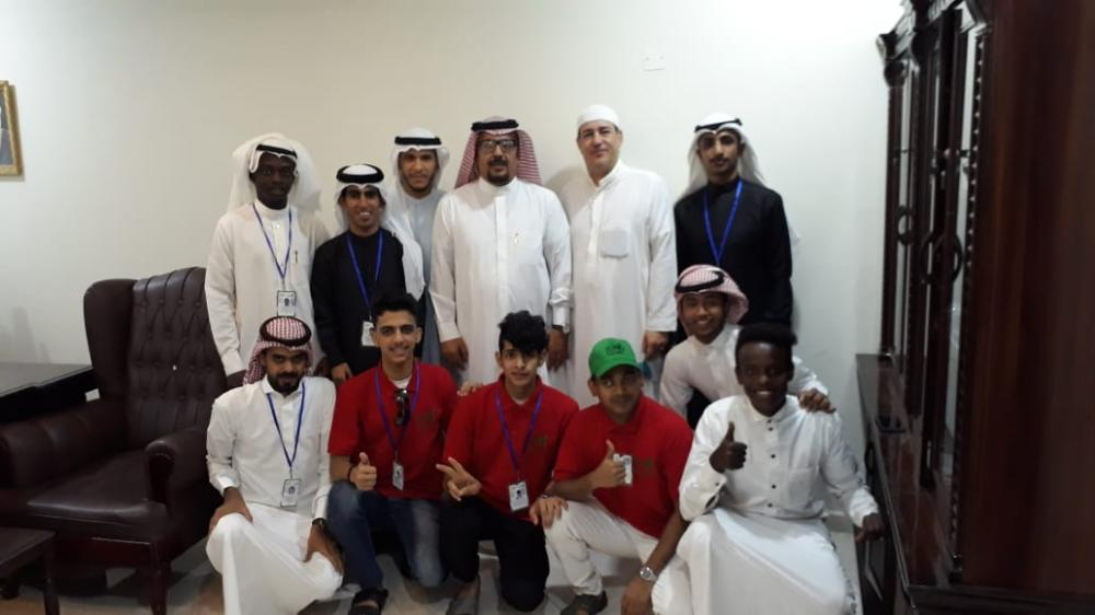 Muhammad Tunisi poses for a photo with some of his employees, including those with special needs.