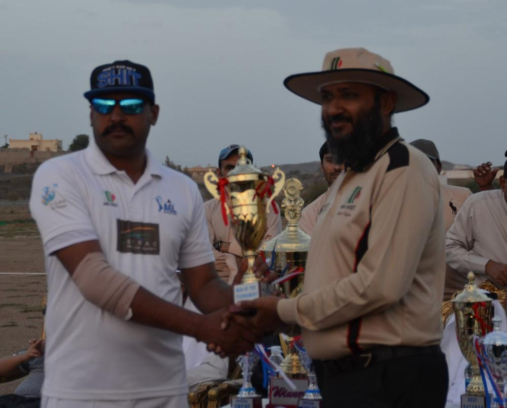 Man of the Match and Tournament Zaigham Abbas receiving award from Kashif Mirza.