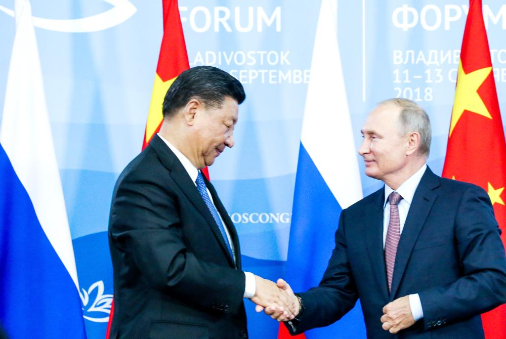 Chinese President Xi Jinping shakes hands with Russian President Vladimir Putin during a signing ceremony following the Russian-Chinese talks on the sidelines of the Eastern Economic Forum in Vladivostok, Russia, on Tuesday. — Reuters