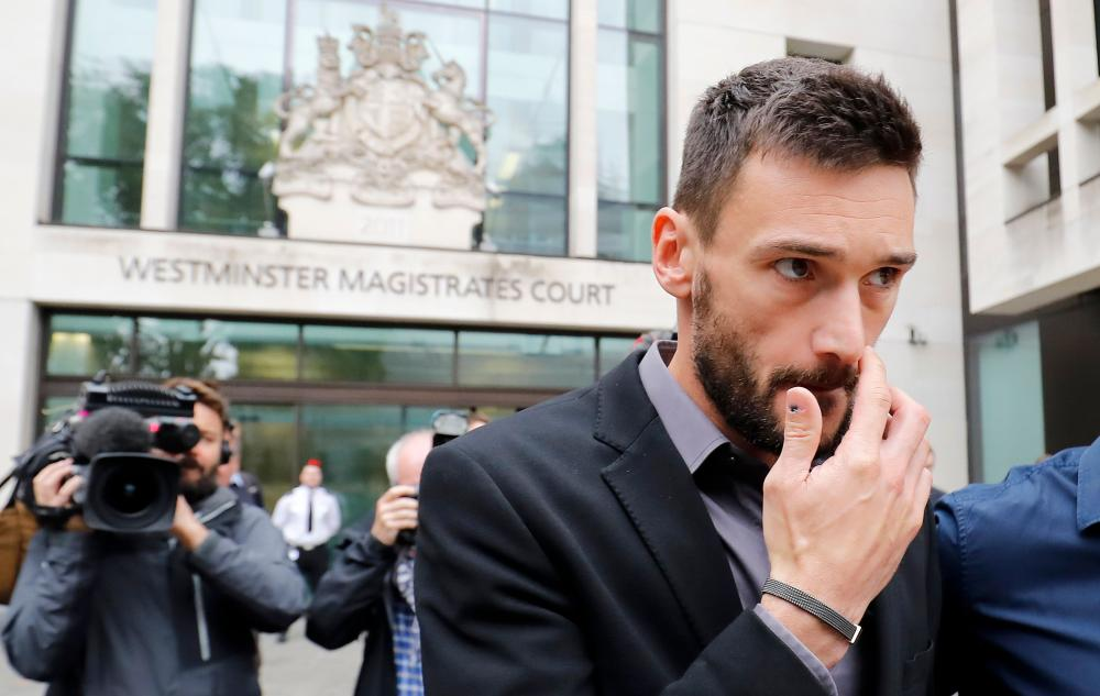 Tottenham Hotspur's French goalkeeper Hugo Lloris leaves after attending Westminster Magistrates Court in central London Wednesday. — AFP