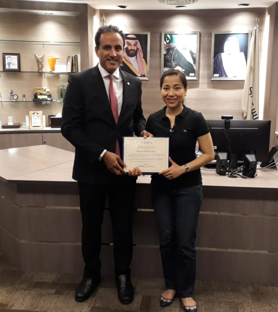 Dr. Jan Charmaine Almonte-Saret receives a certificate of appreciation for her timely interference in safely delivering the baby in mid-air aboard a Saudia flight.