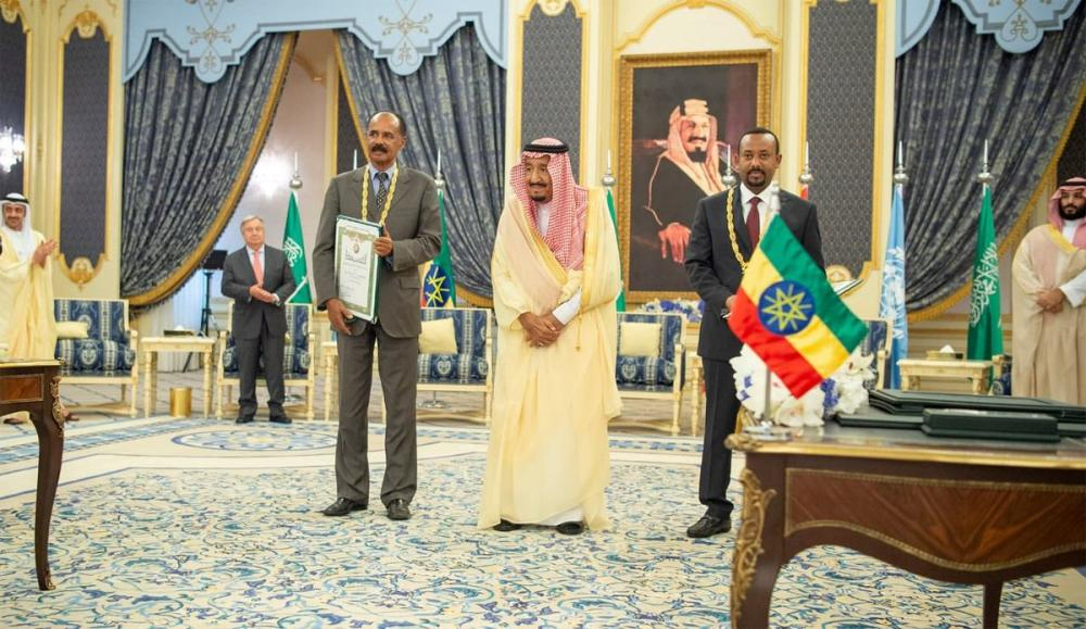 Custodian of the Two Holy Mosques King Salman, Eritrean President Isaias Afwerki (to the right of the King) and Ethiopian Prime Minister Abiy Ahmed Ali stand for a photo after the signing ceremony in Jeddah on Sunday. Crown Prince Muhammad Bin Salman, deputy premier and minister of defense, UN Secretary General Antonio Guterres and UAE Minister of Foreign and International Cooperation Sheikh Abdullah Bin Zayed Al-Nahayan are also seen in the photo. — SPA