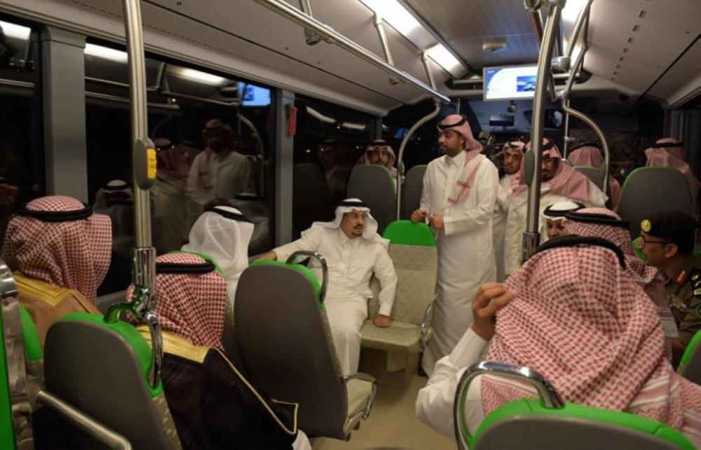 Riyadh Emir Prince Faisal Bin Bandar inspects the new coaches for the bus network project on Monday. — SPA