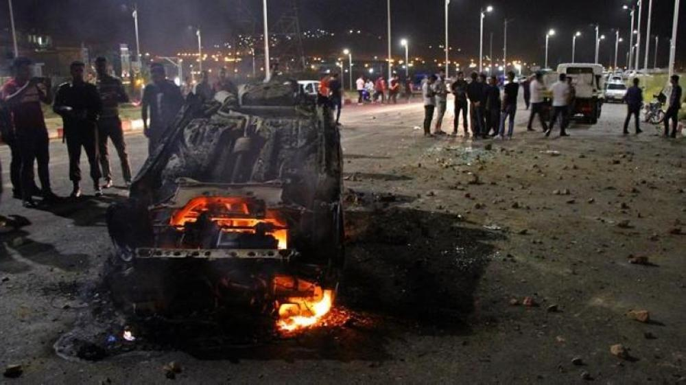 The collision triggered a fireball that engulfed both the truck and the bus. — AFP