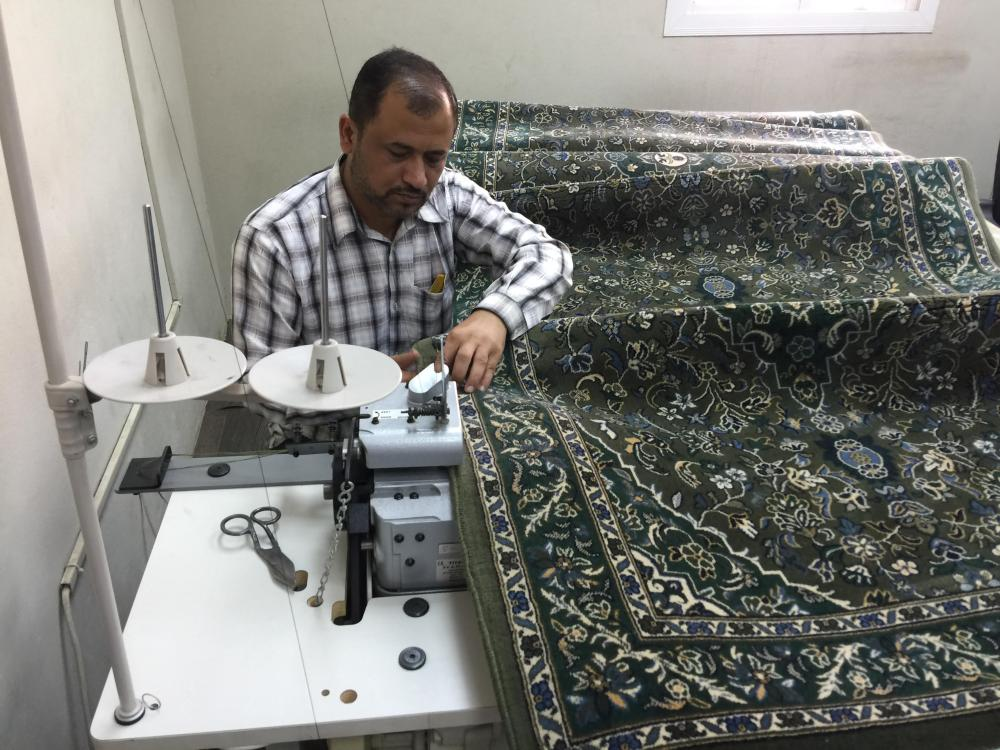 Cleaning prayer rugs a multi-phase mission in Makkah