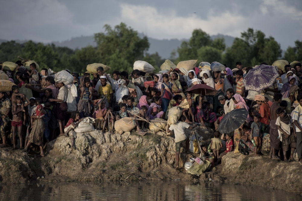 This file photo taken on October 10, 2017, shows Rohingya refugees fleeing from Myanmar arrive at the Naf river in Whaikyang, Bangladesh border. In a final report released on Sept. 18, a UN probe says six members of Myanmar's military including commander-in-chief Senior General Min Aung Hlaing and Vice Senior General Soe Win should be investigated for 'genocide' against the Rohingya after more than 700,000 from the Muslim minority were driven into Bangladesh since August last year. — AFP