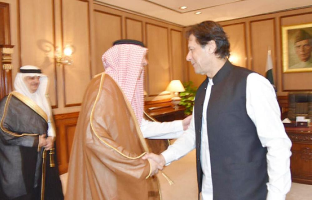 Minister of Media Awwad Al-Awwad with Pakistan Prime Minister Imran Khan during his visit to Islamabad.
