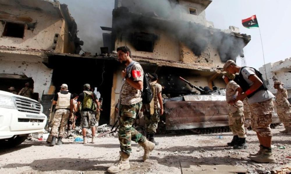 Smoke rises from a ruined house after it was hit by an air strike as fighters from Libyan forces allied with the UN-backed government advance into the last area controlled by Daesh (the so-called IS), in Sirte, Libya, in this file photo. — Reuters