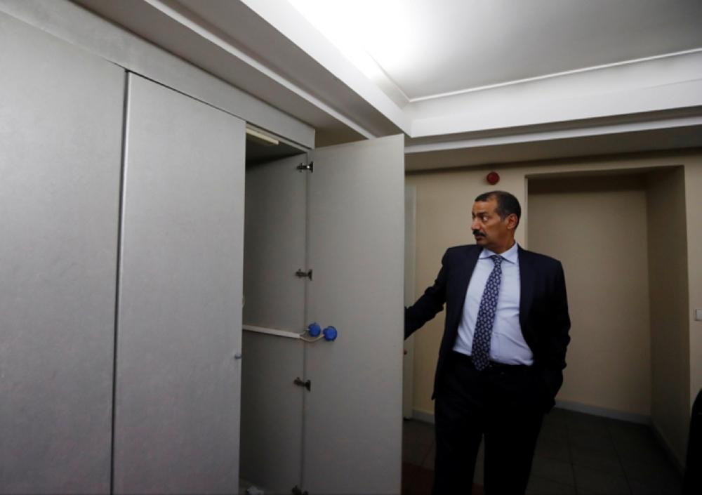 Consul General of Saudi Arabia Mohammad Al-Otaibi opens a cupboard as he gives a tour of Saudi Arabia's consulate in Istanbul to journalists to prove that Jamal Khashoggi is not on the premises. — Reuters