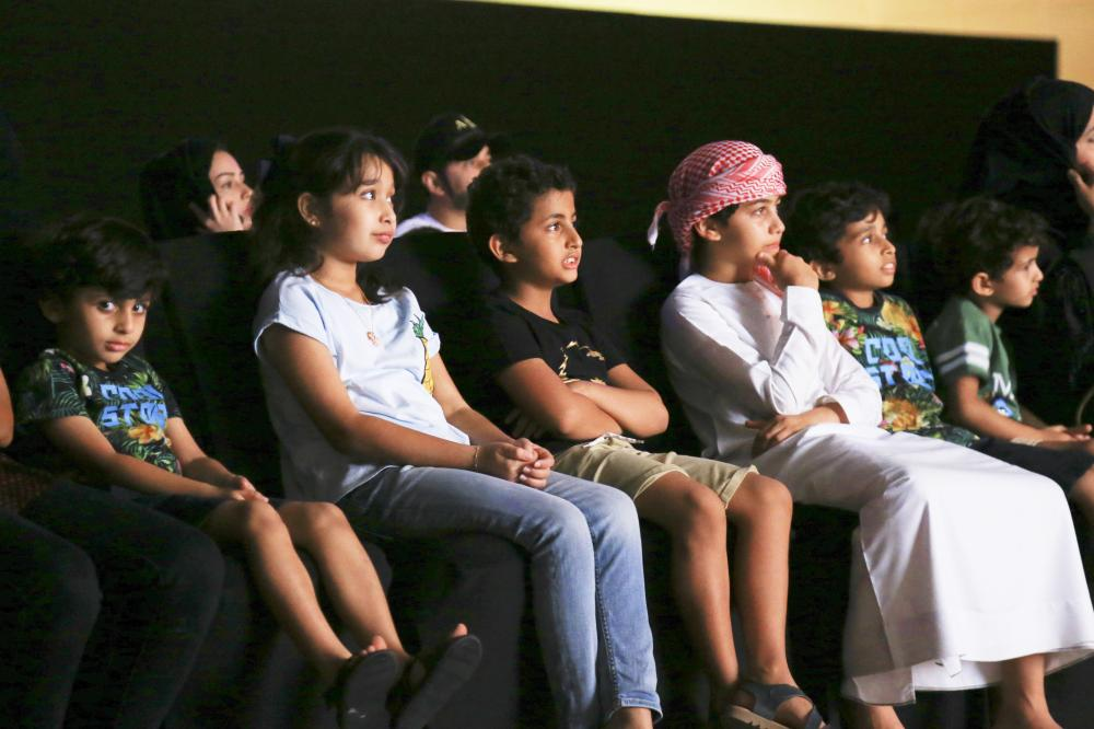 Children engrossed in watching a movie during SICFF 2017
