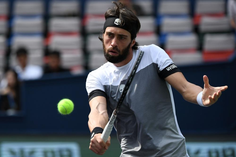 Nikoloz Basilashvili of Georgia hits a return against Alexander Zverev of Germany during their match at the Shanghai Masters Tennis Tournament Wednesday. — AFP