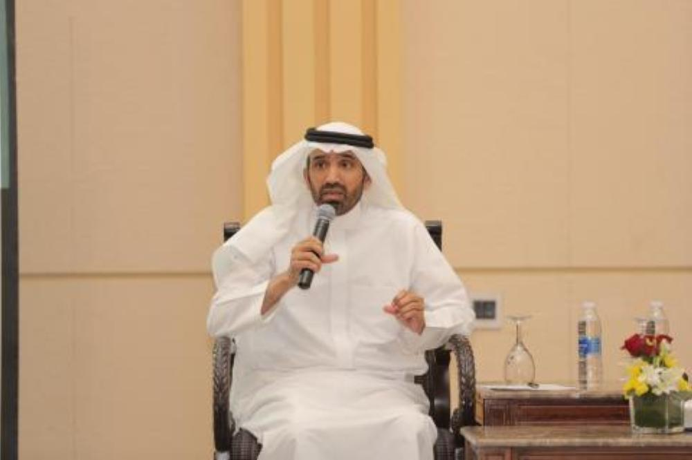 Minister of Labor Ahmed Al-Rajhi speaking at the workshop in Riyadh.