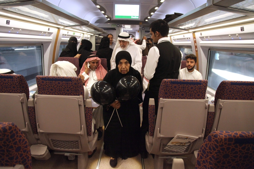 Passengers walk inside a wagon at Makkah's train station on Thursday as the new high-speed railway line linking the two holy cities opens. — AFP
