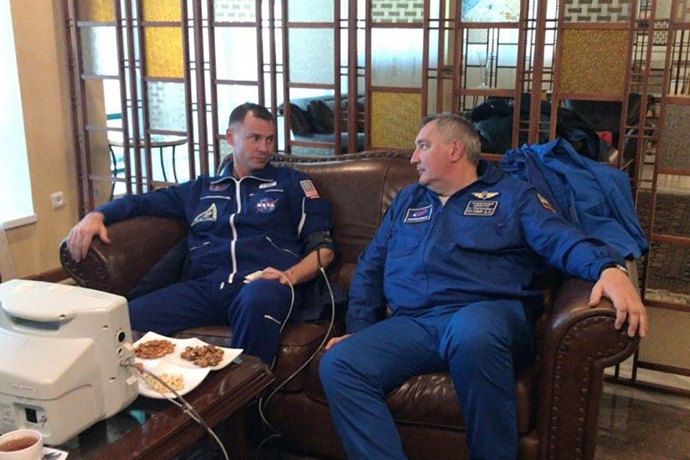 In this handout picture released on Russia's space agency Roscosmos Twitter account on Thursday, NASA astronaut Nick Hague, left, undergoes medical examination in the town of Dzhezkazgan (Zhezkazgan), Kazakhstan.