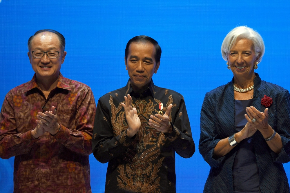 World Bank President Jim Yong Kim, Indonesia President Joko Widodo and IMF Managing Director Christine Lagarde clap their hands during attend Balifintech Seminar at International Monetary Fund-World Bank Annual Meeting 2018 in Nusa Dua, Indonesia, on Thursday. — AFP