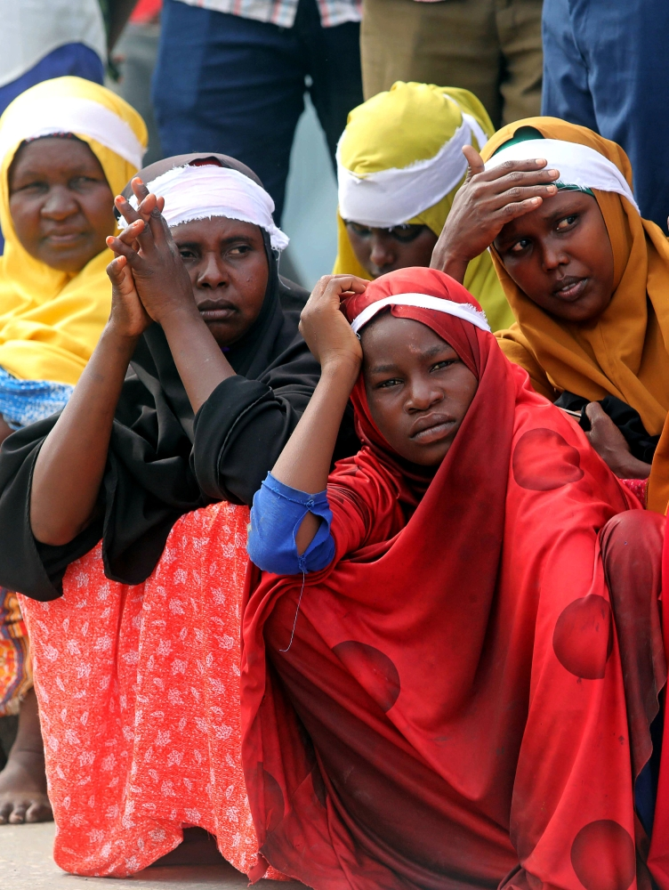 Civilians gather near the scene to mark the first anniversary of a terror attack in the Hodan district of Mogadishu, Somalia, on Sunday. — Reuters