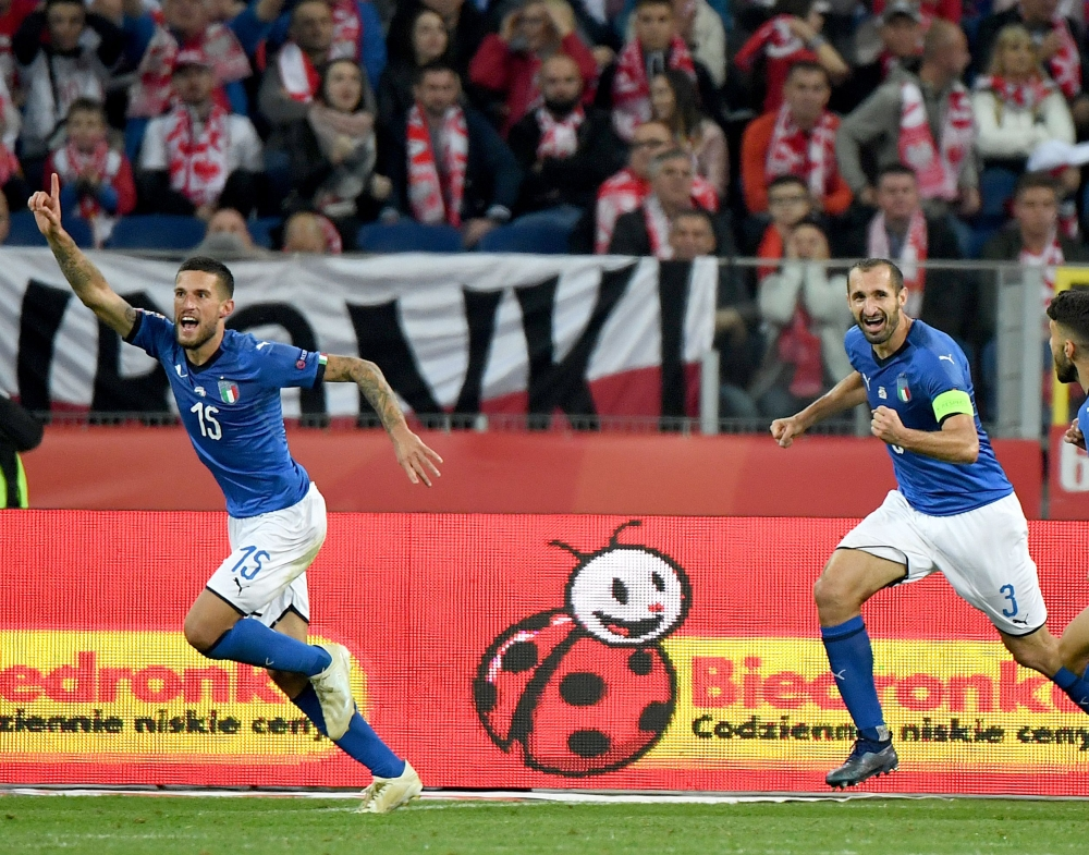 Italy's defender Cristiano Biraghi (L) celebrates scoring with Italy's defender Giorgio Chiellini during the UEFA Nations League football match against Poland at the Silesian Stadium in Chorzow, Poland, on Sunday. — AFP