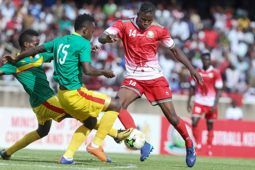 Kenya's Michael Olunga (R) vies with Ethiopia's Antene Tesfaka (L) and Ashalew Tamene during the AFCON 2019 qualifier football match between Kenya and Ethiopia at Kasarani stadium in Nairobi, on Sunday.  — AFP