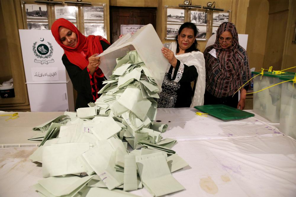 Election officials count ballots after polls closed during the general election in Islamabad, Pakistan, in this July 25, 2018 file photo. — Reuters