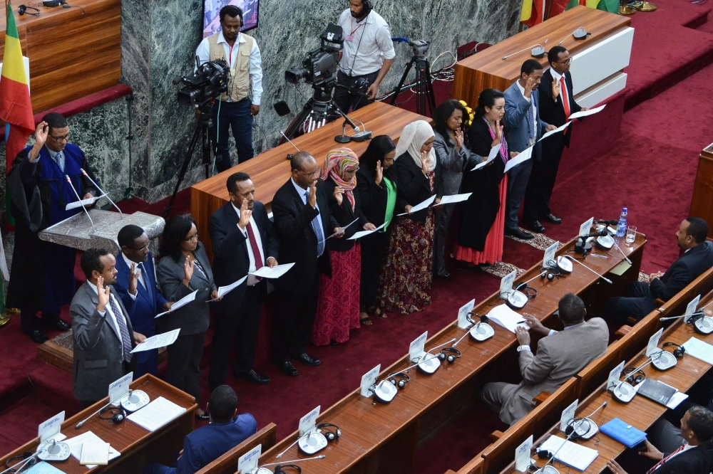 Ethiopia's newly appointed ministers take their oath of office at the parliament in the capital Addis Ababa on Tuesday. — AFP