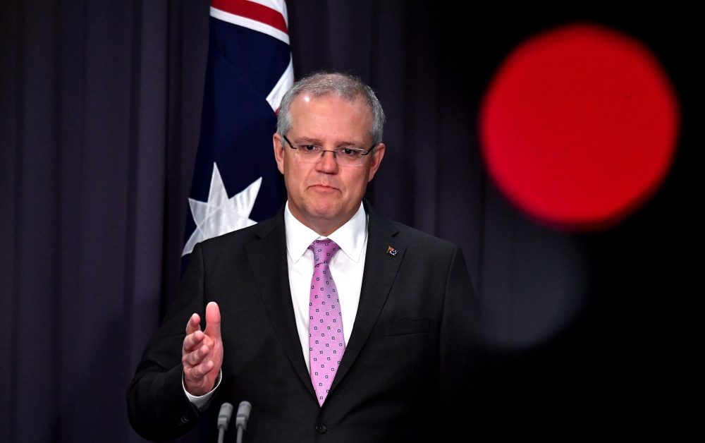 Prime Minister Scott Morrison speaks to the media during a press conference at Parliament House in Canberra, Australia, on Tuesday. — Reuters