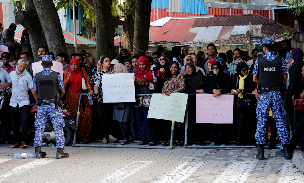 Maldives opposition supporters protest as the Supreme Court of the Maldives began to hear a petition challenging the outcome of last's month election in Male, Maldives, in this Oct. 14, 2018 file photo. — Reuters