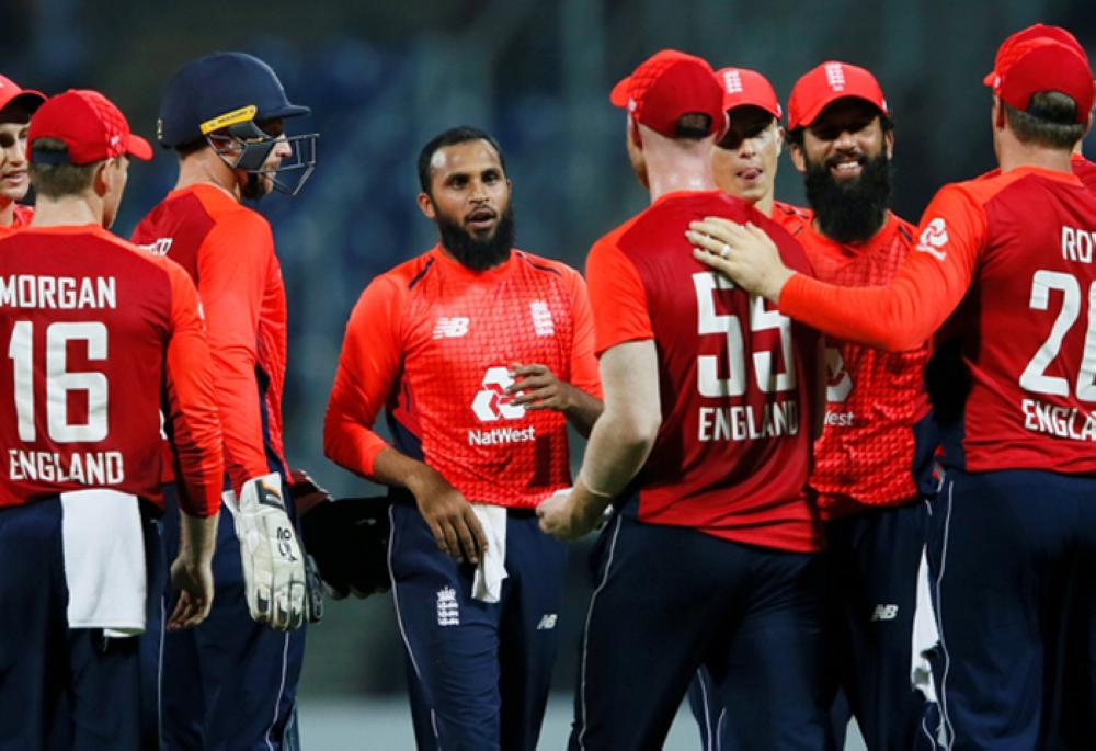 England's Adil Rashid (C) celebrates with his teammates after taking the wicket of Sri Lanka's Thisara Perera (not pictured). — Reuters