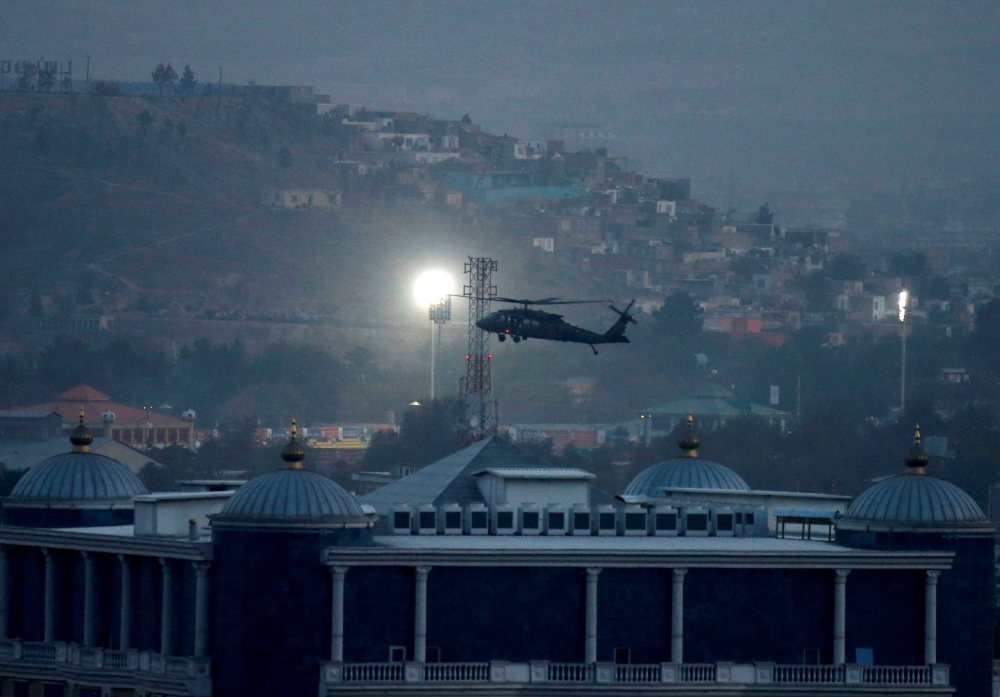 A NATO helicopter lands at the Resolute Support headquarters in Kabul, Afghanistan, on Thursday. — Reuters