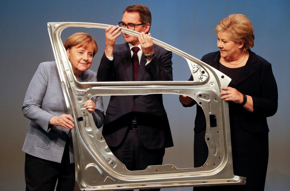 File photo shows German Chancellor Angela Merkel, Svein Richard Brandtzaeg, president and chief executive Officer of Rolled Products and Norwegian Prime Minister Erna Solberg are seen during the official opening of a production line for the car industry at a branch of Norway's Hydro aluminum company in Grevenbroich, Germany. — Reuters