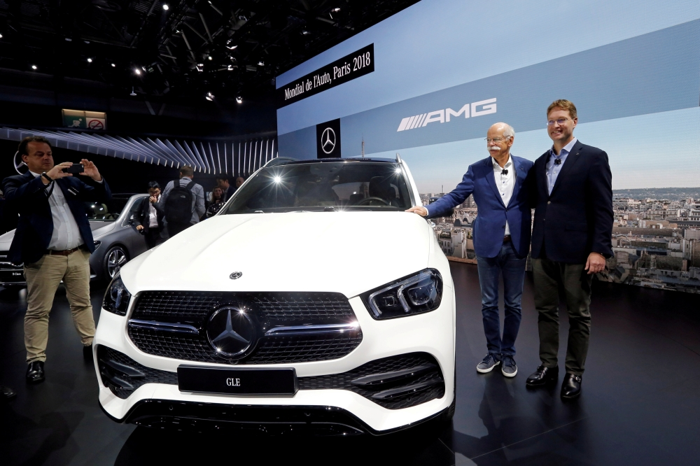 Dieter Zetsche, chairman of the board of management of Daimler AG, and Ola Kallenius, member of the board of management of Daimler AG, present the Mercedes GLE during a press conference on the first press day of the Paris auto show, in Paris, France, recently. — Reuters
