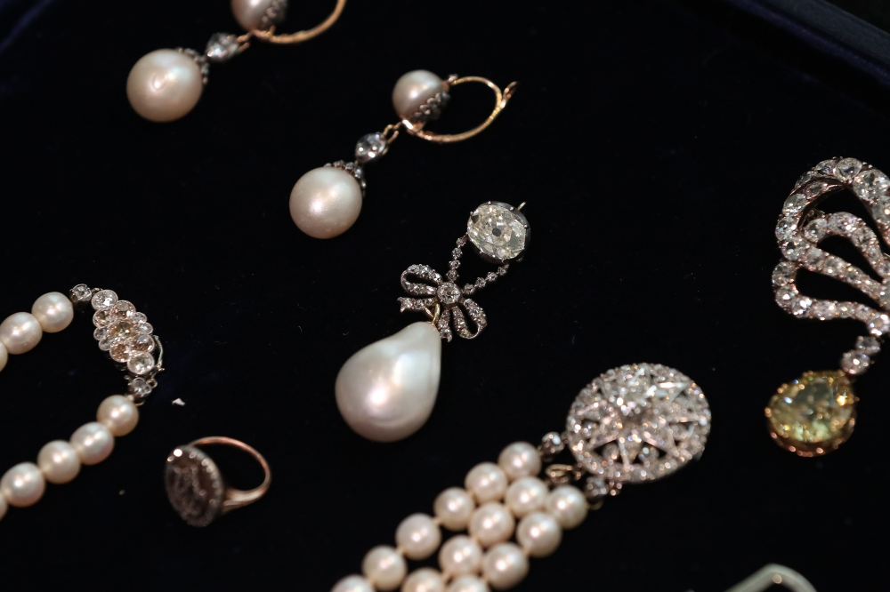 The 'Queen Marie Antoinette's Pearl', center, with an estimated value of £767,500-£1,534,000 is pictured with other jewelry during a photo-call for the sale of 'Royal Jewels from the Bourbon Parma Family' at Sotheby's auction house in London on Friday. — AFP