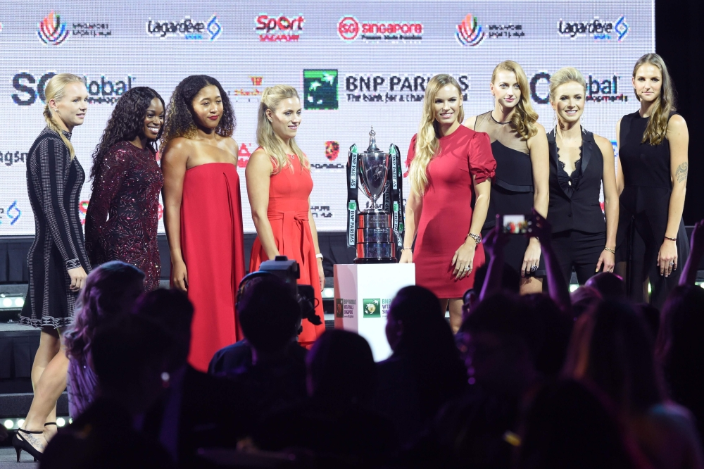 From left to right, Karolina Pliskova of Czech Republic, Sloane Stephens of the US, Naomi Osaka of Japan, Angelique Kerber of Germany, Caroline Wozniacki of Denmark, Petra Kvitova of the Czech Republic, Elina Svitolina of the Ukraine and Kiki Bertens of the Netherlands pose during the official draw ceremony and gala of the WTA Finals Singapore at Marina Bay Sands Hotel on Friday in Singapore. — AFP