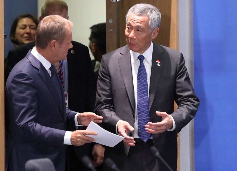 European Council President Donald Tusk and Singapore's Prime Minister Lee Hsien Loong attend the EU-ASEAN meeting on the sidelines of the EU-ASEM summit in Brussels, Belgium, on Friday. — Reuters