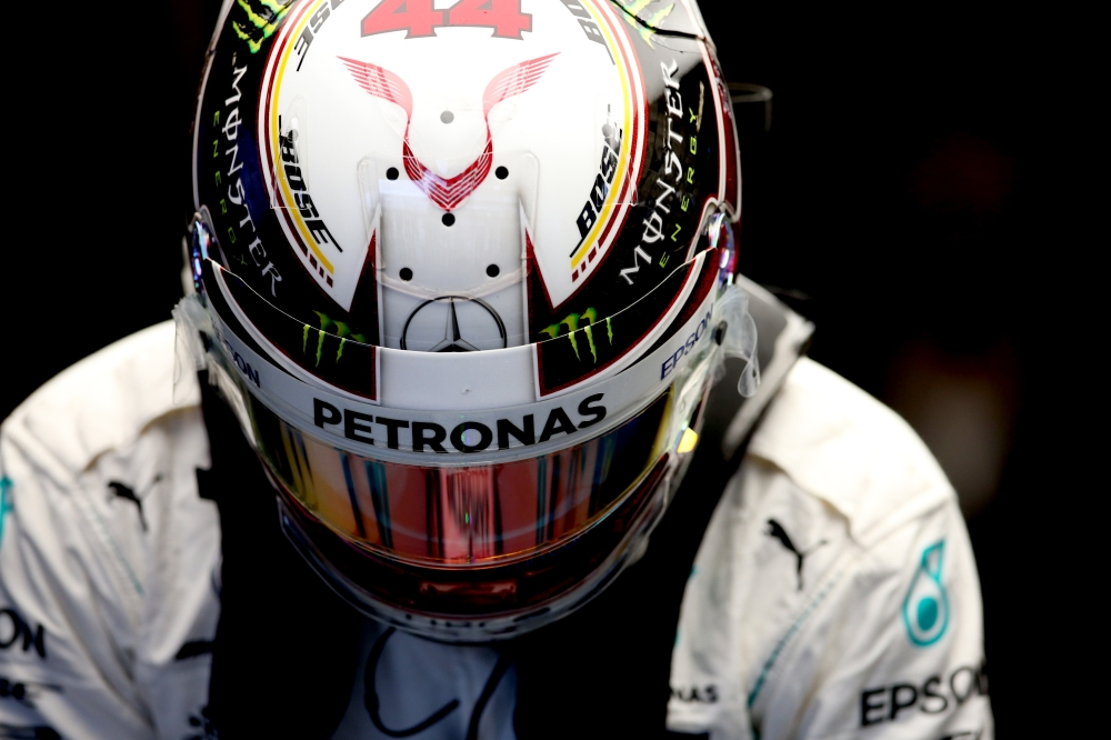 Lewis Hamilton of Great Britain and Mercedes GP prepares to drive in the garage during practice for the United States Formula One Grand Prix at Circuit of The Americas on Friday in Austin, United States. — AFP