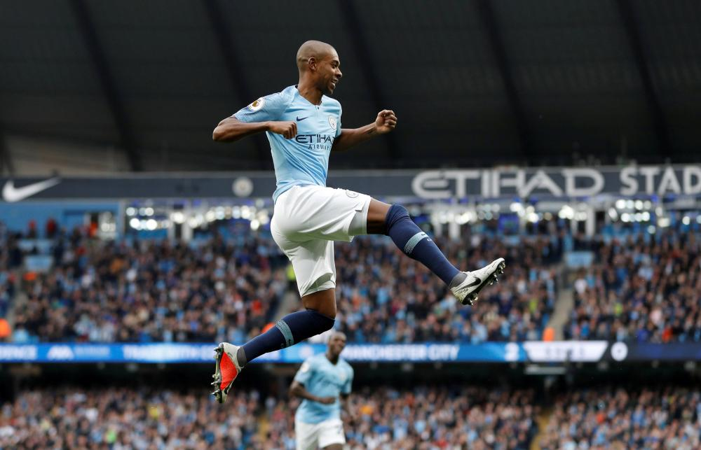 Manchester City's Fernandinho celebrates after scoring their third goal against Burnley during their English Premier League match at Etihad Stadium, Manchester, Saturday. — Reuters