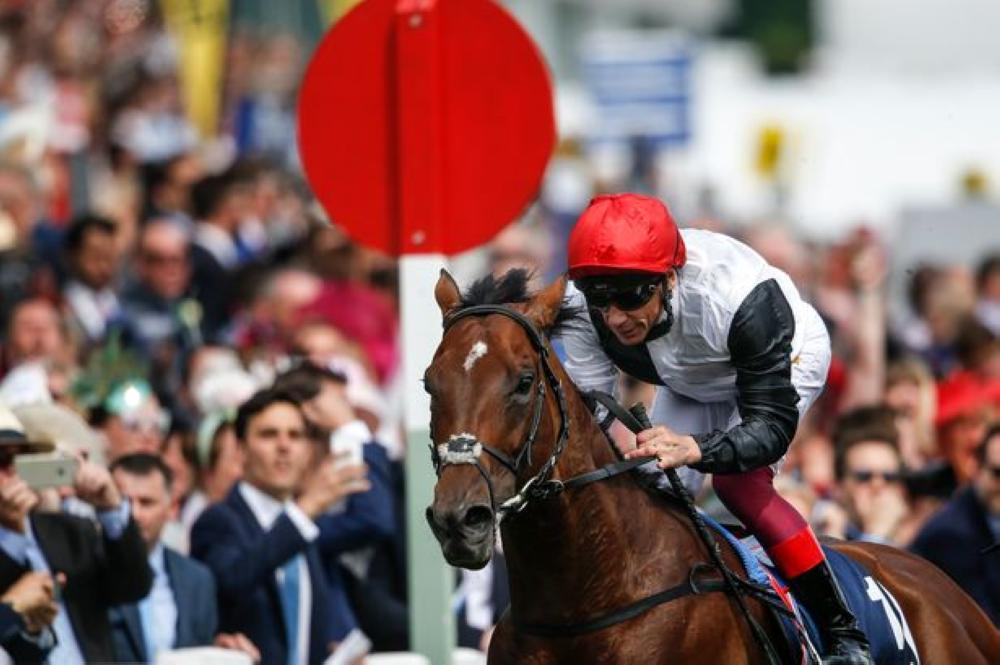 Frankie Dettori riding Cracksman.