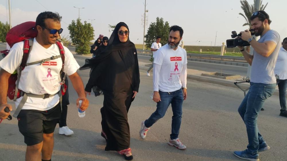 Princes Haifa and Samer Kurdi walk with Yasser Al-Humaid (L) after the reception in Asfan.