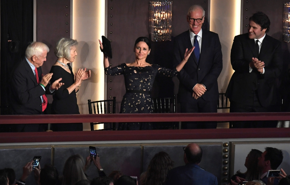Comedian and actor Julia Louis-Dreyfus acknowledges applause as she arrives to be awarded the Kennedy Center's 21st annual Mark Twain Prize for American Humor, in Washington. — Reuters