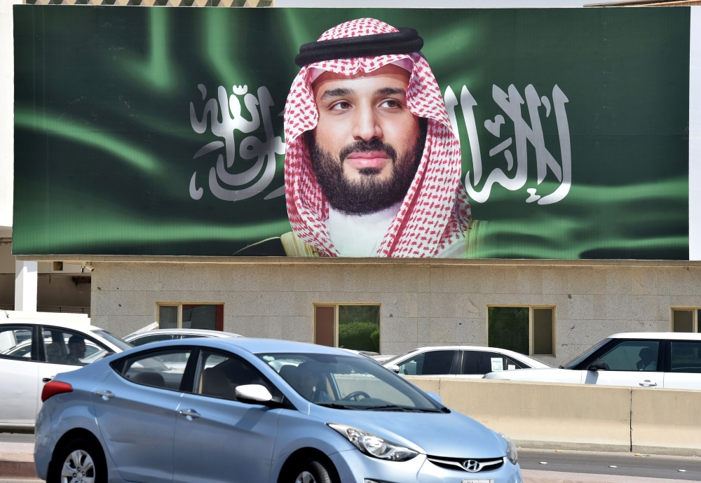 A portrait of Crown Prince Muhammad Bin Salman is displayed in Riyadh on Monday one day ahead of the Future Investment Initiative. — AFP