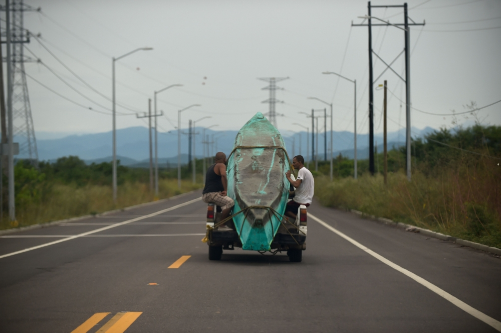 Men transport a boat on a truck in Teacapan, Sinaloa state, Mexico, on Monday, before the arrival of Hurricane Willa. — AFP