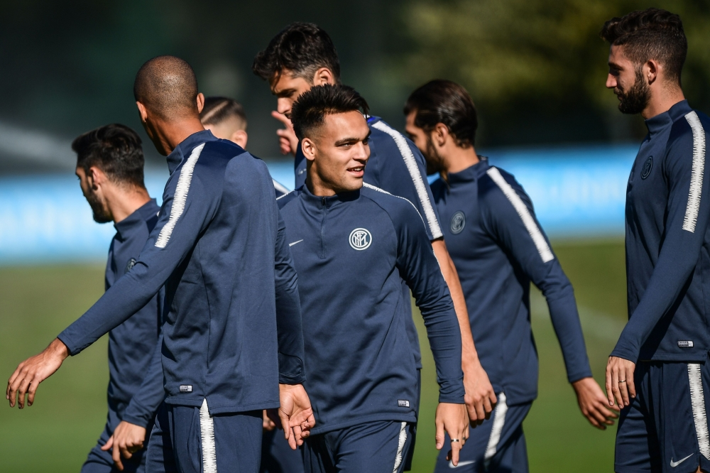 Inter Milan players take part in a training session at the Appiano Gentile training ground, near Como, on the eve of the UEFA Champions League group stage match against Barcelona Wednesday. — AFP