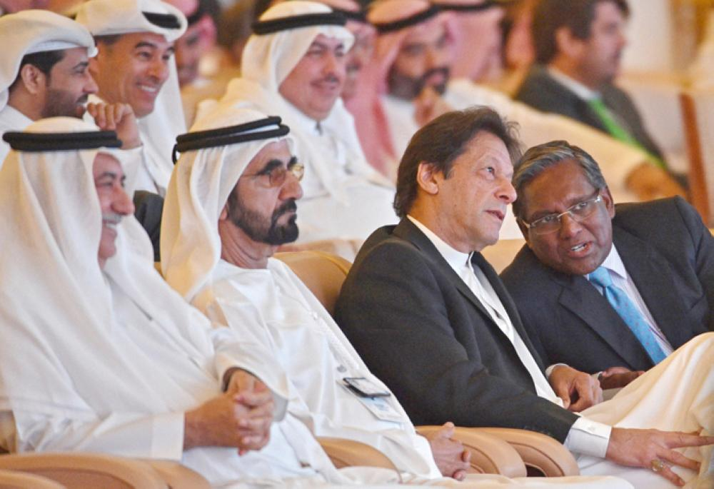 Dubai Ruler Mohammed Bin Rashid Al-Maktoum (2 L), Saudi state Minister Ibrahim Al-Assaf and Pakistani Prime Minister Imran Khan (2 R) attending the opening ceremony of the Future Investment Initiative FII conference taking place in Riyadh on Tuesday.  — AFP