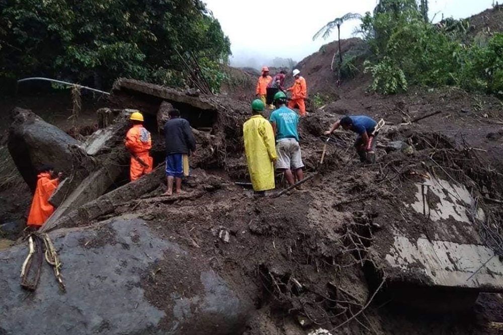 Rescuers look for survivors after a landslide in Natonin, Mountain Province in the northern part of the Philippines, on Wednesday. — AFP